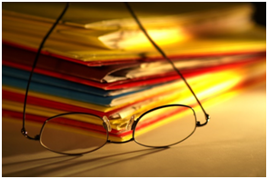 file folders and glasses