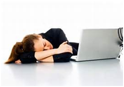 Woman with head down sleeping on desk